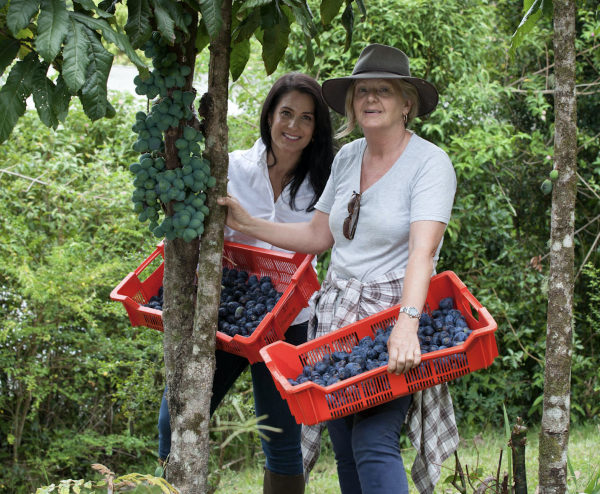 Lisa Carroll Managing Director Native Extracts with a Davidson Plum supplier